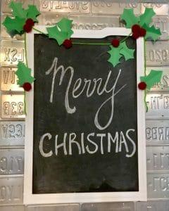 Merry Christmas written on chalkboard
