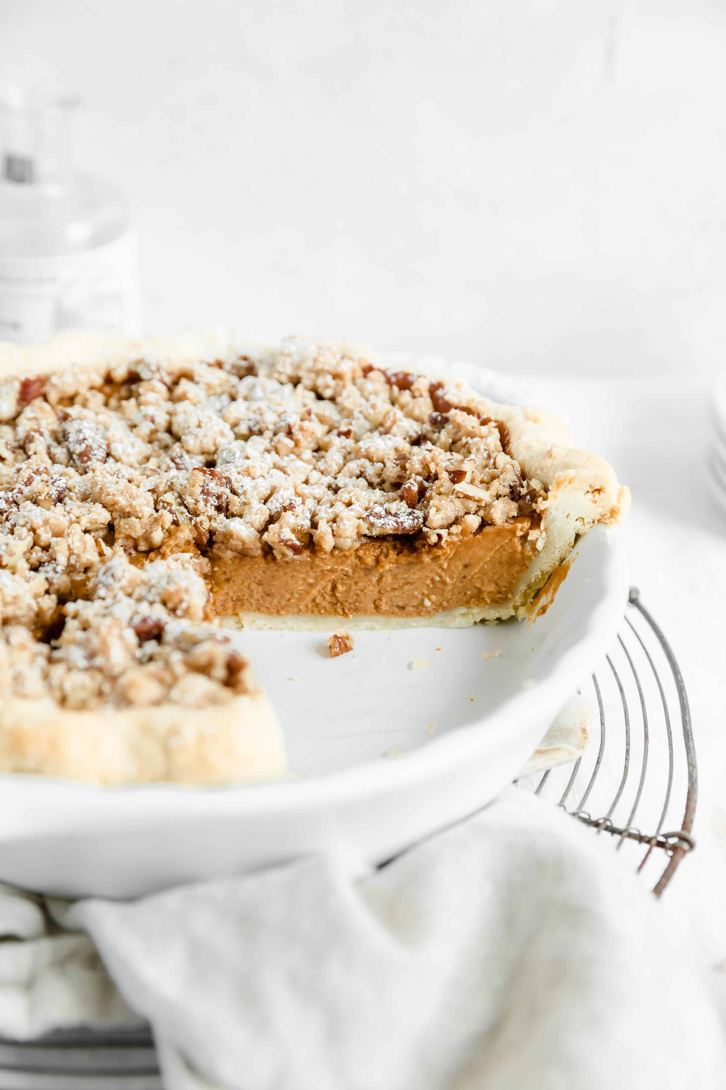 45 degree angle shot of cross section of sweet potato crumble pie