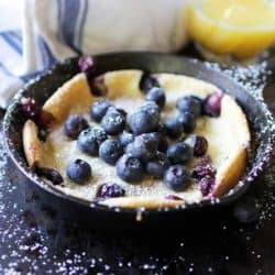 Dutch Baby Pancake with berries on top in mini skillet