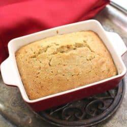 zucchini bread in a small red baking dish