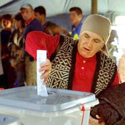 Man casting vote in Kosove Election in the year 2000.