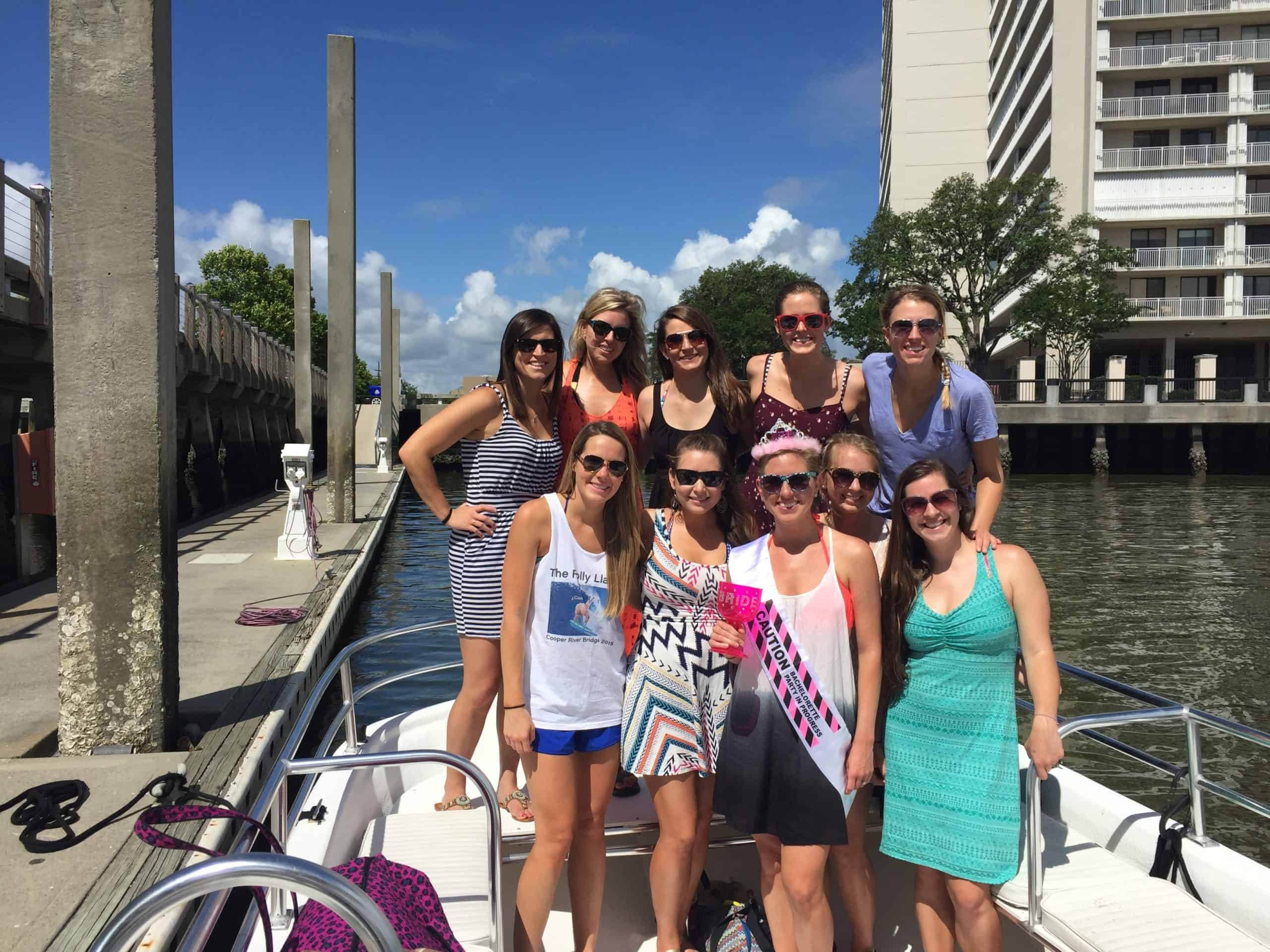 Group of women taking a picture before they go out on their adventure on the boat. Charleston booze cruise bachelorette