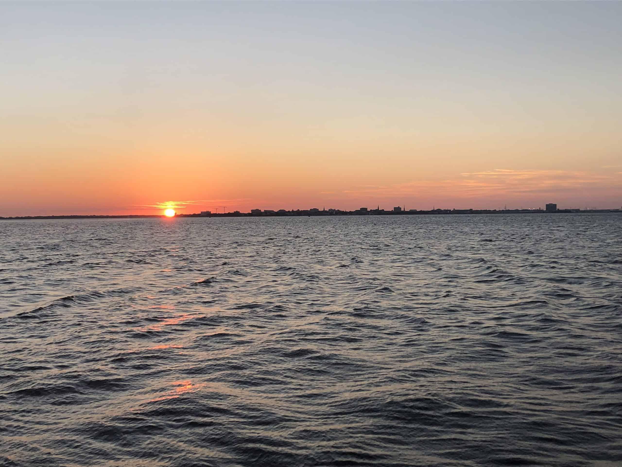 Sun setting on water. Sunset cocktail cruise Charleston, SC