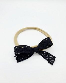 Taupe nylon haarbandje met zwarte kanten strik