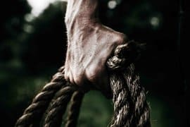 man-holding-brown-rope-