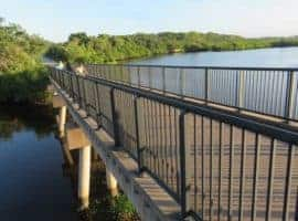 Long bicycle bridge over water.