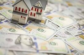 Small Model House on Newly Designed U.S. One Hundred Dollar Bills.
