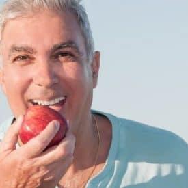 Man Biting Apple