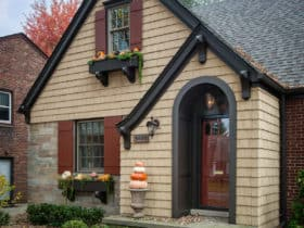 charming cottage style with pella tan front door color and beige siding exterior