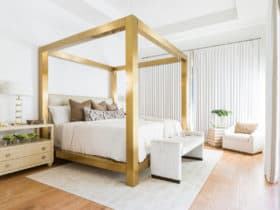 contemporary white bedroom with gold bed frame for a sense of grandeur