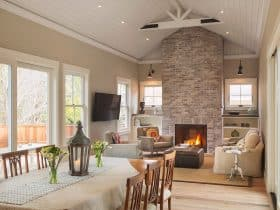 farmhouse living room with limewash brick fireplace