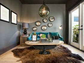 grey and teal living room with brown bear skin rug