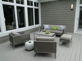 a dark grey shingle siding paired with a light grey deck