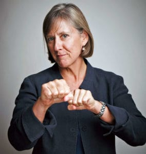 This executive shot of Mary Meeker seems to show her powerful and in action. But the garment style and color fail to support these elements of her personality. This is how onlookers become confused about a person's credibility.