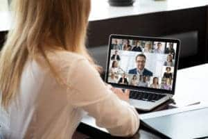 4-tips-for-managing-newly-remote-worker People engaged in group videocall, laptop screen webcam application view