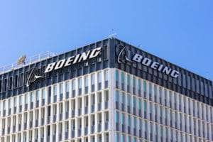 boeing-swot-analysis Boeing Manufacturing Facility and Logo