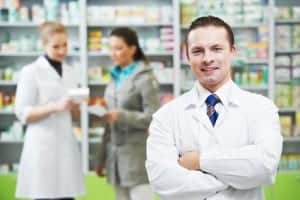 Confident pharmacy chemist man in drugstore