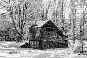 A black and white photo of an old barn in Ulster Park after a snow storm.