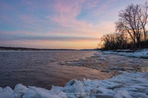 A photo of a sunset over the Hudson River on a February evening at Charles Rider Park.