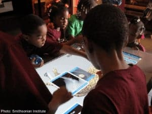 Kids use interactive tables at the smithsonian in washington dc