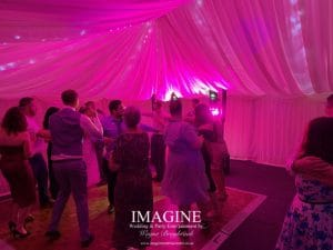 Nicola & Tom's evening wedding reception in a Marquee in the grounds of the Nyton Hotel in Ely