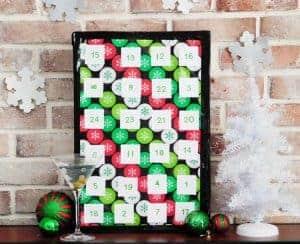 mini alcohol bottle advent calendar tabletop against brick wall