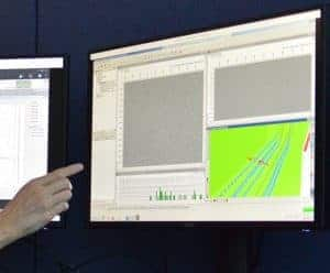finger pointing at computer screen