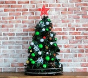tomato cage christmas tree on counter by brick wall
