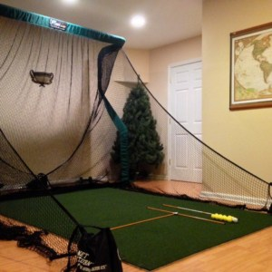 the net return indoor golf hitting mat with golf alignment sticks and golf practice balls