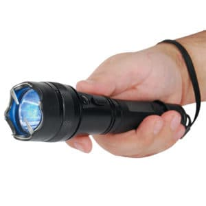 15,000,000 volt flashlight stun gun in hand pointing forward