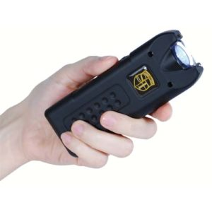 black rechargeable with alarm and flashlight multiguard stun gun in hand