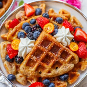 buttermilk cinnamon waffles with maple syrup, cream and fruit