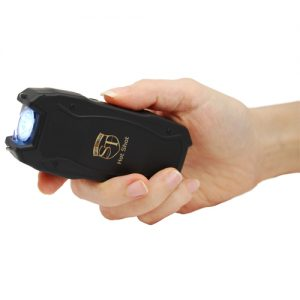 Hot shot stun gun woman's hand