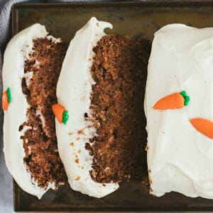 A carrot cake loaf that has been sliced.