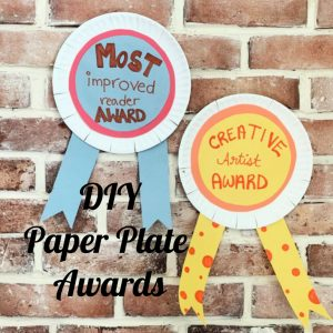 paper plate awards on brick wall