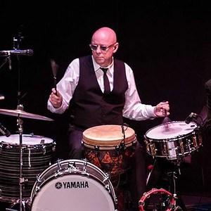 John Wittmann playing drums.