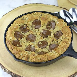 Peanut Butter Cup Oatmeal Chocolate Chip Skillet Cookie