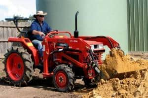 Ken Gray moves earth with the front end loader on his remanufactured Kubota tractor.