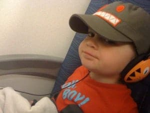 toddler on a plane, young child on a plane, preschooler on a plane, flying with toddlers