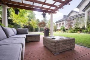 wood stained pergola and painted porch