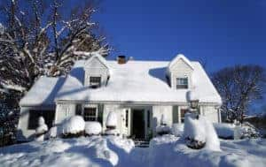 snow covered house in need of exterior painting