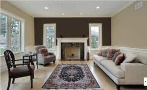 accent wall in living room painted in van dyke brown