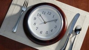Plate with a clock, eat slow to avoid unnecessary calories