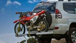 motorcycle in a hitch carrier in suv car