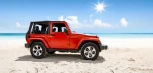 ed jeep with soft top in a beach