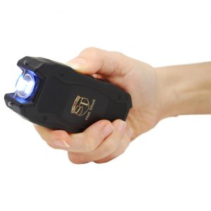 Hot Shot Stun Gun with Flashlight Side View in hand at an angle with Light Activated