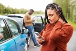 Woman contacting her insurance company after a vehicle accident