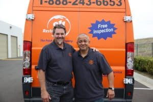 911-restoration-water-damage-mold-remediation-fire-damage-person-van-two-owners