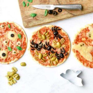Overhead shot of three Halloween pizzas