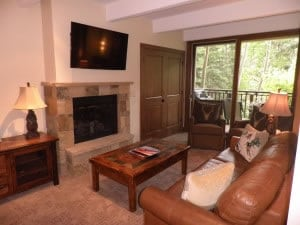 A new fireplace, entertainment center with additional storage space.